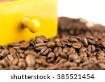 coffeebeans infront of a coffee ... | Shutterstock . vector #385521454