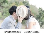 Couple In Love Kissing Behind...