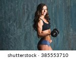 female bodybuilder with... | Shutterstock . vector #385553710