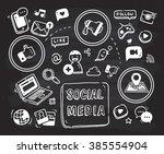social media themed doodle on... | Shutterstock . vector #385554904