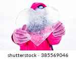 ice in the shape of heart | Shutterstock . vector #385569046