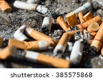 Cigarette Butts On A Gray...
