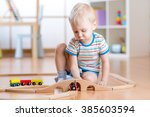 child boy playing with wooden... | Shutterstock . vector #385603594