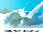 splash of milk  pouring jet... | Shutterstock . vector #385636660