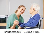 happy geriatric nurse holding...   Shutterstock . vector #385657408