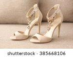 bride's high heel shoes on sofa | Shutterstock . vector #385668106