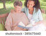 elder lady is reading a book in ... | Shutterstock . vector #385675660
