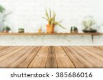 wooden board empty table in... | Shutterstock . vector #385686016