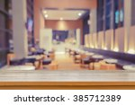 empty brown wooden table and... | Shutterstock . vector #385712389