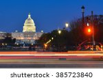 Stock photo washington dc at night us capitol building with car lights trails foreground 385723840