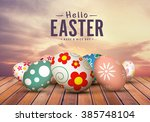 color easter eggs on wooden... | Shutterstock . vector #385748104
