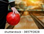 Bowling Ball At Hand Of Man...