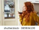 young redhead woman standing in ... | Shutterstock . vector #385836130