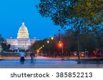 Stock photo washington dc at night us capitol building with car lights trails foreground 385852213