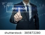 Small photo of Businessman hand touching ARBITRAGE button on virtual screen