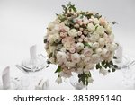 table setting at a luxury... | Shutterstock . vector #385895140