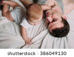 portrait of loving father with... | Shutterstock . vector #386049130