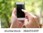 close up of a hand pointing at... | Shutterstock . vector #386053309