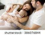 happy family with newborn baby | Shutterstock . vector #386076844