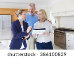 female realtor showing mature... | Shutterstock . vector #386100829