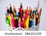 colored pencils in white pretty ... | Shutterstock . vector #386101150