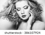 portrait of a beautiful woman | Shutterstock . vector #386107924