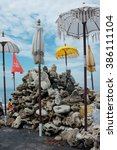 Small photo of Balinese-Hindu offerings and sculptures of Buddha and Ganesh (Ganesha) form a Hindu-Buddhist shrine to protect the beach from evil and tsunamis at Pantai Purnama in Bali, Indonesia.