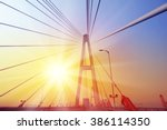 suspension bridge against... | Shutterstock . vector #386114350