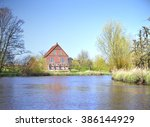 wetland or marshland with reeds.... | Shutterstock . vector #386144929