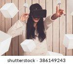 woman in virtual reality helmet.... | Shutterstock . vector #386149243