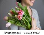 women's hands are holding a... | Shutterstock . vector #386155960