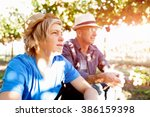 father and son in vineyard | Shutterstock . vector #386159398