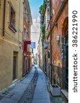 narrow street in sassari old... | Shutterstock . vector #386221990