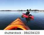 A Man And A Red Kayak In A Bay...