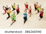 little gymnasts doing exercises ... | Shutterstock . vector #386260540