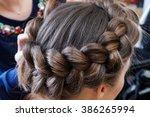 weave beautiful braids in a... | Shutterstock . vector #386265994