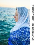 young muslim smiling woman in... | Shutterstock . vector #386280868