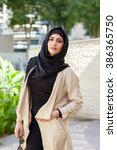 smiling girl in hijab covering...   Shutterstock . vector #386365750