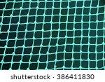 synthetic fishing net macro | Shutterstock . vector #386411830