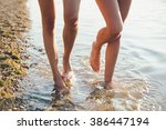 female legs walking in water on ... | Shutterstock . vector #386447194