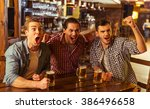 three young men in casual... | Shutterstock . vector #386496658