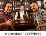 two men are smiling  looking at ...   Shutterstock . vector #386498980