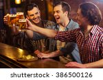three young men in casual... | Shutterstock . vector #386500126