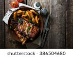grilled ribs with potatoes | Shutterstock . vector #386504680