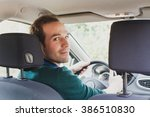 portrait of driver in the car... | Shutterstock . vector #386510830