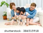 asian family playing with pet... | Shutterstock . vector #386515918