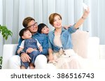 asian family taking selfie at... | Shutterstock . vector #386516743
