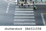 people are moving across the... | Shutterstock . vector #386521558