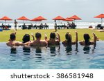 people has a rest in the pool... | Shutterstock . vector #386581948