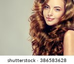 beautiful girl with long wavy... | Shutterstock . vector #386583628